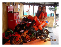 Girls at a photo shot on KSL air conditioing and refigeration sponsored BSB motorcycle, 01634 290999 for details.